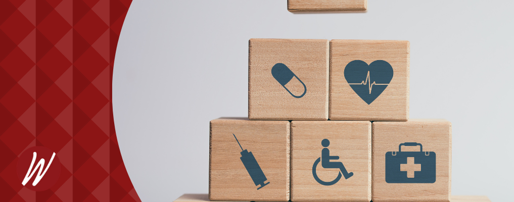 ACA Compliance images on stacked wood blocks